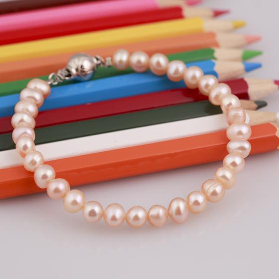 Opal - vòng tay ngọc trai hồng cam xinh xắn cho bé