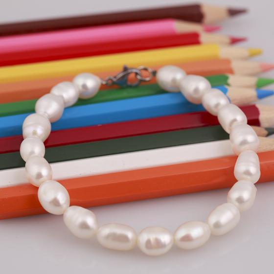 Opal - vòng tay ngọc trai trắng cho bé