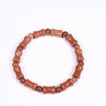Vòng tay đá san hô hóa thạch màu đỏ đốt 12x8mm mệnh Hỏa, Thổ - Ngọc Quý Gemstones