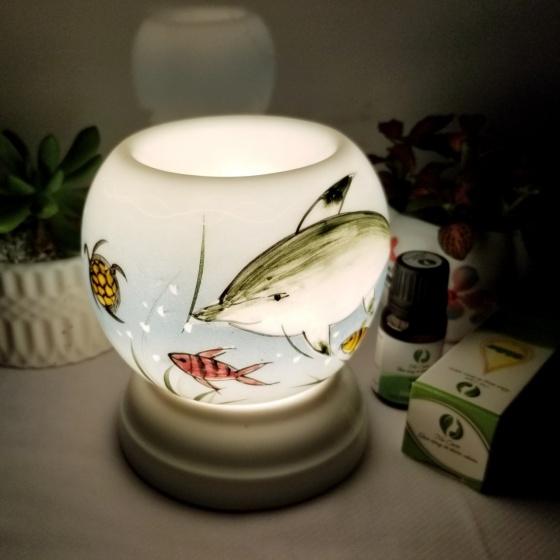 Đèn xông tinh dầu mini tặng 01 lọ tinh dầu sả chanh 5ml NuCare và 01 bóng đèn dự phòng (MN21)