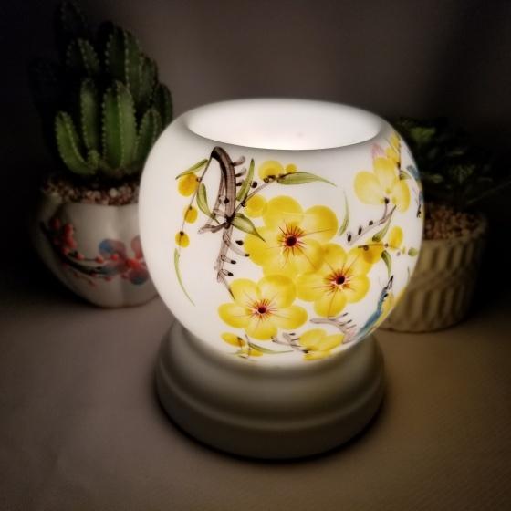 Đèn xông tinh dầu mini tặng 01 lọ tinh dầu sả chanh 5ml NuCare và 01 bóng đèn dự phòng (MN23)